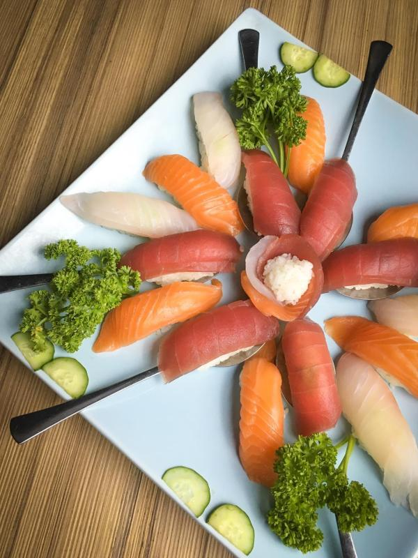 Savor any of these delectable open-faced seafood sushi.
