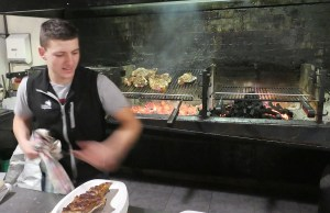 Action shot of the young chef (barely) grilling our steaks