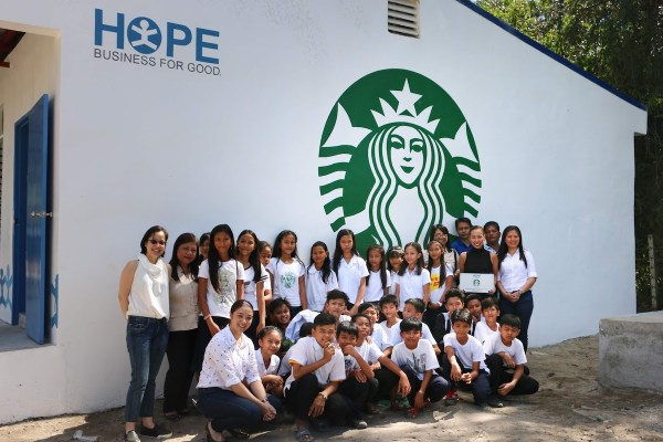 Students of Archbishop Emilio Cinense Memorial Integrated School in San Fernando, Pampanga thank Starbucks and Friends of Hope for the gift of a new classroom.