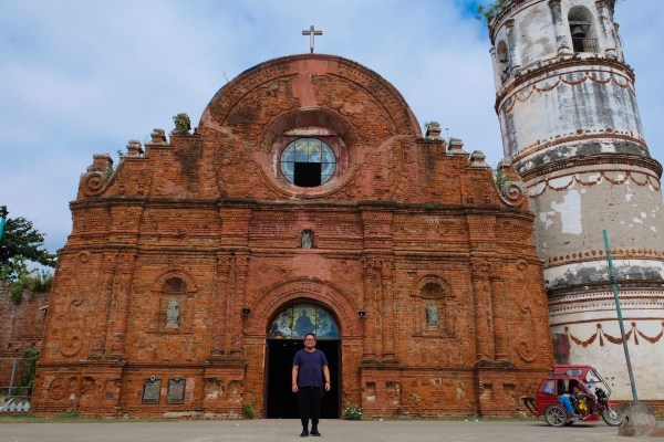 The author in front of the Church of Tumauini in Isabela Province