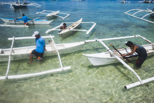 Paddle Boats to snokeling sites - by Fabian Encarnacion