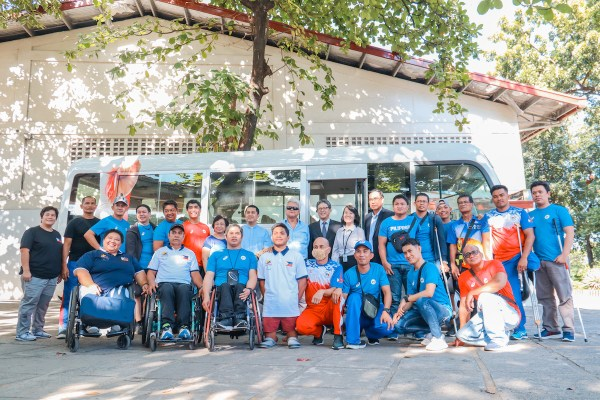 PPC officials, athletes and coaching staff together with TMP officials during the turnover of the Toyota Coaster donated by TMP to support the Paralympic movement in the Philippines.