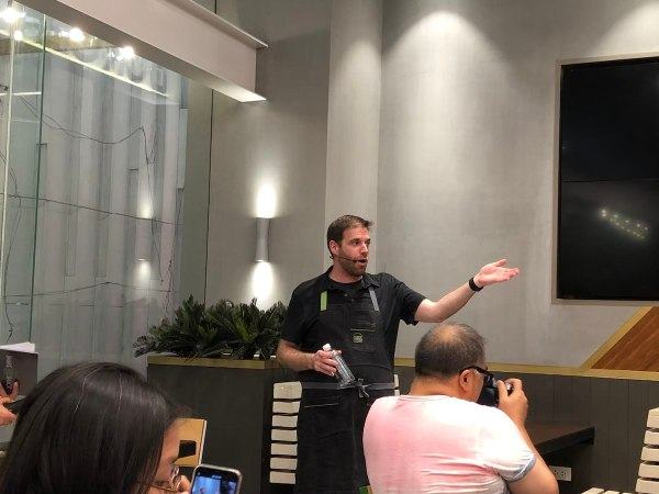 Mark Rosati explaining to guests the history and dishes of Shake Shack.