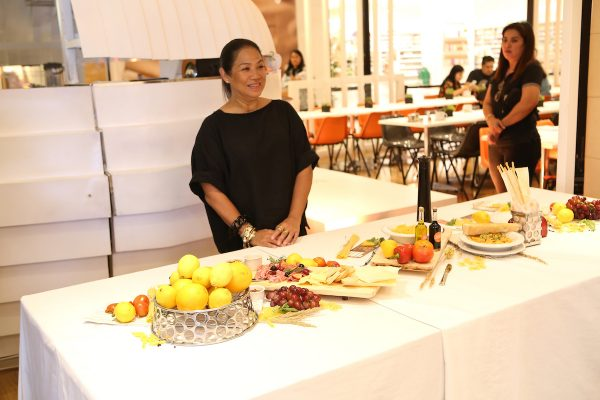 Chef Margarita Fores serving authentic Italian meal at the event
