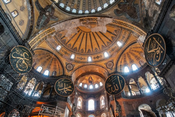 Christian gold mosaics and Muslim symbols on the ceiling of the Aya Sofya. Six Sights to See in Sultanahmet Square