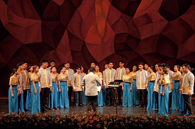 DYCI Dagalak, 2018 Mixed Voices Junior Choir Category National Champion with conductor Nelson dela Cruz.