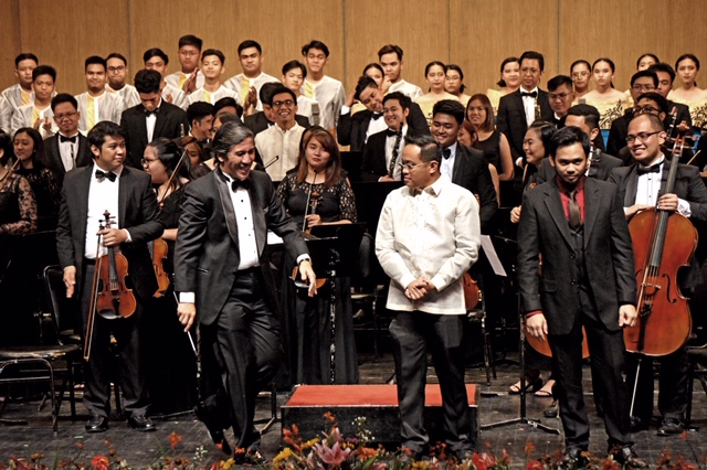 (L-R) Foreground: Gabriel Art Mendoza (USTSO Concert Master, Airra May Punzalan (USTSO Assistant Concert Master), Dr. Renato B. Lucas (NAMCYA President) , Nelson Dela Cruz (DYCI Dagalak conductor) , Giancarlo Castrillo Gonzales (cello soloist 2008 NAMCYA Lower Strings Category Champion) Background: UST Symphony Orchestra