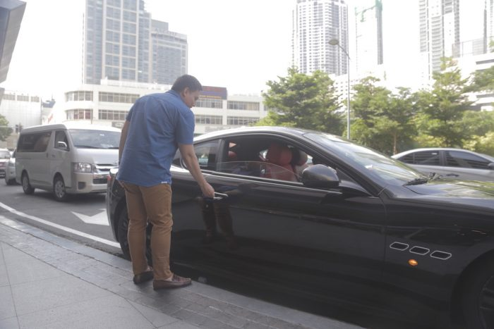 the author, riding a Maserati to the RCBC Bankard event