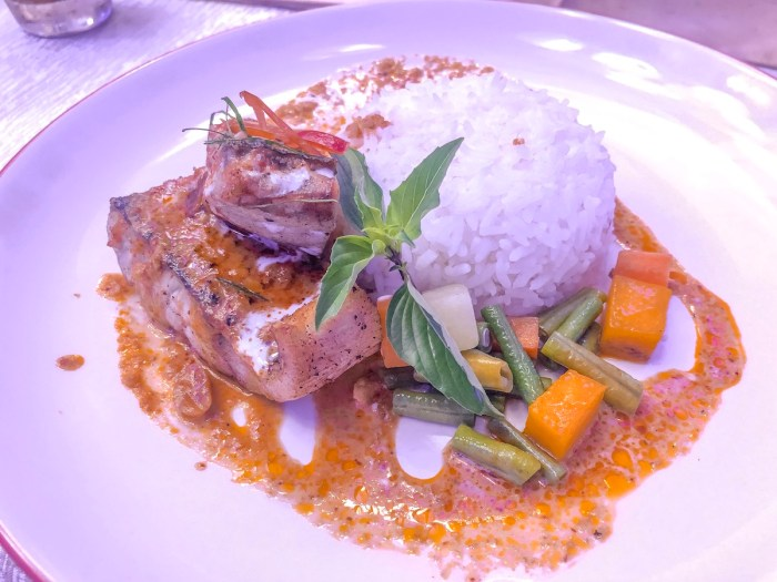 Chu-che Pla, a Thai dish made from pan-fried barramundi fish, red curry with coconut milk, kaffir lime, and steamed rice