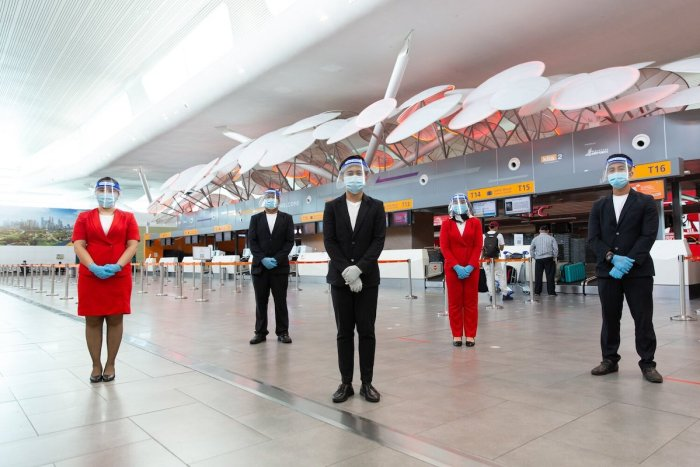 GTR guest service agent wearing personal protective equipment on duty at Kuala Lumpur International Airport (Kalia 2).