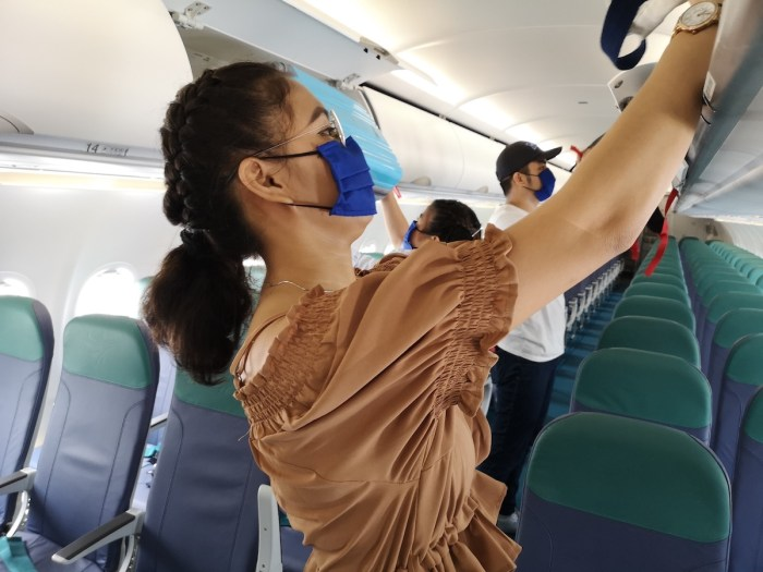 Cebu Pacific stewing in overhead cans