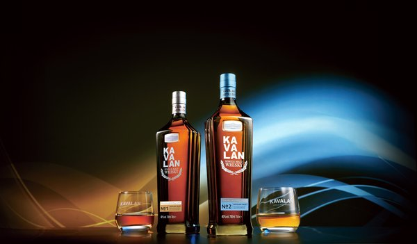 """With its rich earth color, the Taipei 101-shaped bottle for the Kavalan Distillery Select Series symbolizes the foundational core strengths of Kavalan's cask selection and blending art. On the left, """"Kavalan Distillery Select No. 1,"""" is rich in fruitiness intertwined with cream and toffee notes. On the right, """"Kavalan Distillery Select No. 2"""" blends floral and herbal notes, mature woodiness and warm spiciness."""