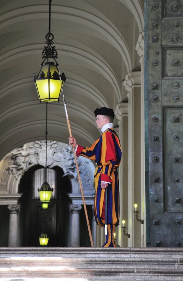 A Swiss Guard standing by one of the entrances. Michelangelo designed their uniforms.