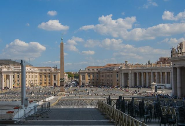 The view of Piazza San Pietro with the famous Bernini columns on the right and chairs being laid out for a special Mass.