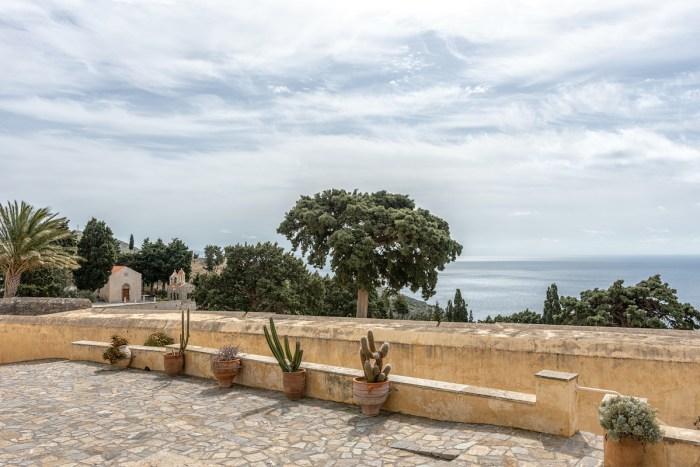 View of Preveli monastery courtyard with the church of Saint John in Greece, Crete island photo via Depositphotos