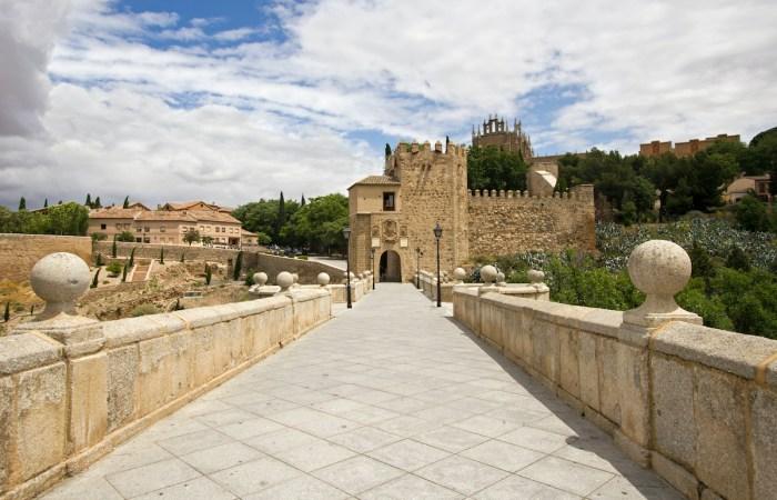 Puente de San Martin in Toledo photo via Depositphotos