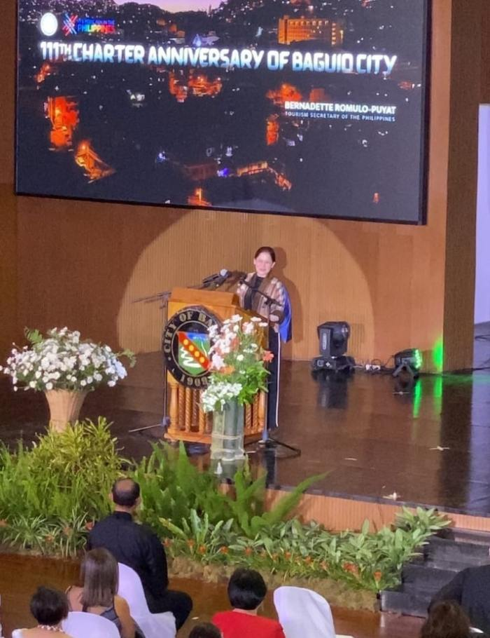 Tourism Secretary Bernadette Romulo-Puyat delivers her keynote speech at the 111th Baguio Day celebration, wherein she expressed the DOT's support to Baguio City's tourism recovery plans, and called for a sustainable and responsible reopening of tourism in the city.