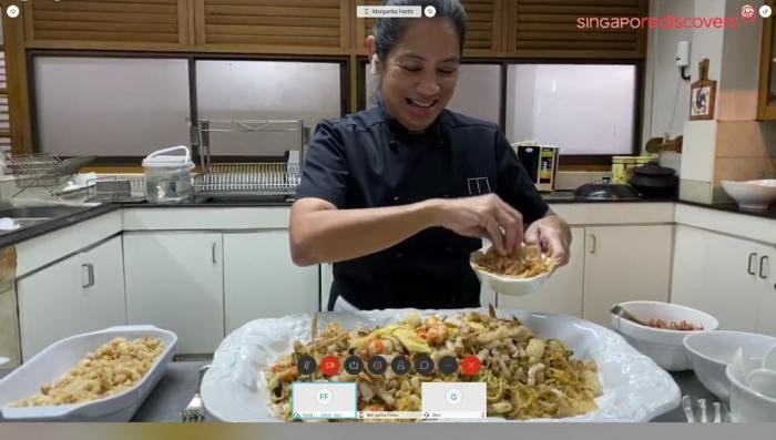 International Chef Margarita Forés, owner of such restaurants as Cibo and Grace Park, adds the finishing touches to her own version of Hokkien Mee by topping it with generous amounts of crispy fish.