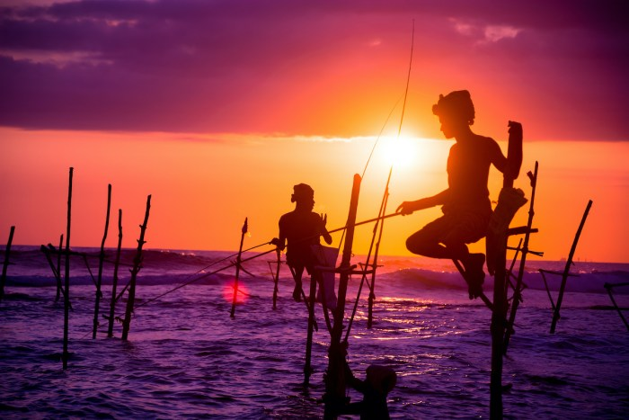 Sri lankan traditional stilt fisherman via Depositphotos