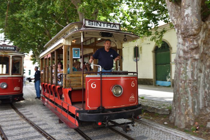 Sintra street scene with old red trams via Depositphotos