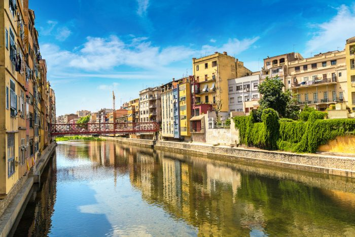 Colorful houses in Girona photo via Depositphotos