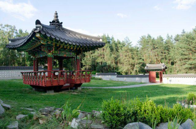 Traditional Korean style pagoda in Hryshko National Botanical Garden photo via Depositphotos