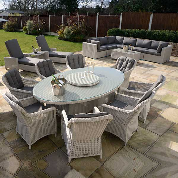 black rattan chair cowhide chairs nz henley 8 oval dining set - pebble outside edge metal garden furniture