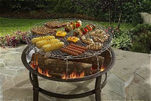 MR. BAR-B-Q Large Round Cooking Grate on a Fire Pit