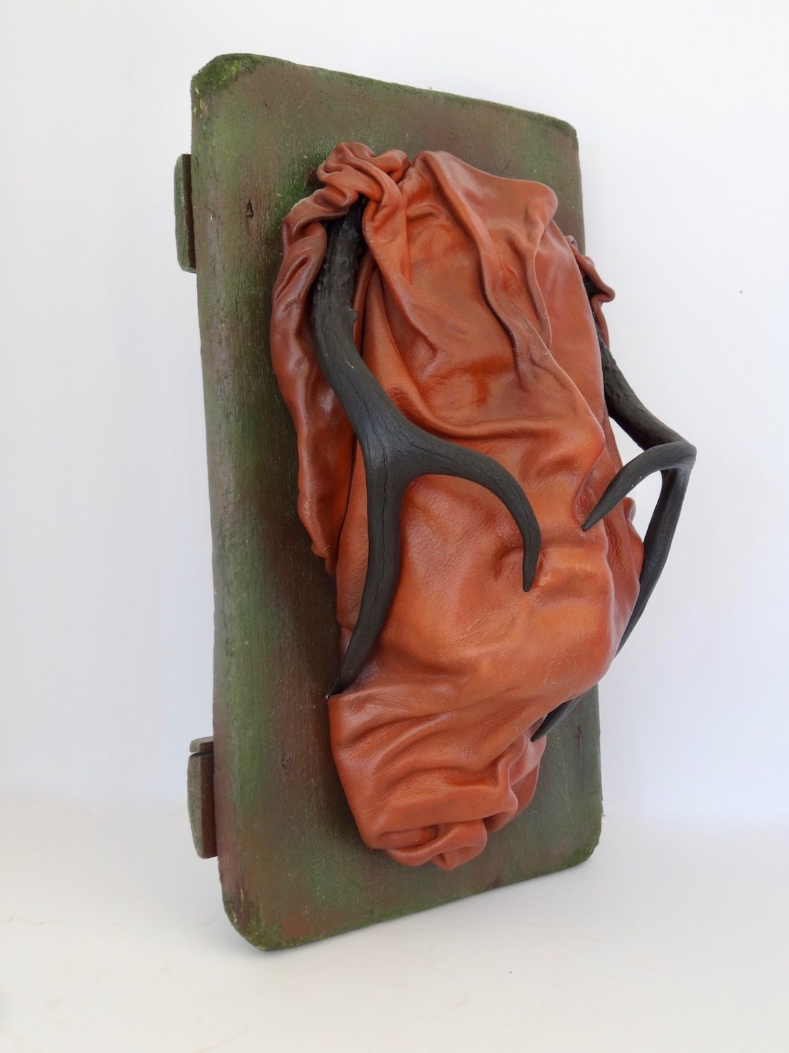 "Title The Man on the Bus Medium Mixed Media Assemblage, wet molded leather, antique objects Size 16""H x 10""W x 6""D"