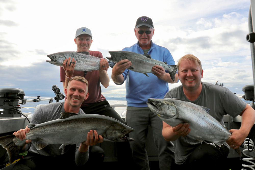 four men with some nice bc salmon
