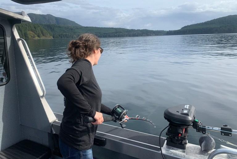 woman jigging for fish bc