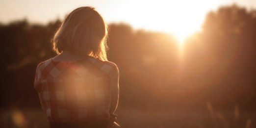 Picture of a woman anxiously looking in the distance. Anxiety Treatment at Outside the Norm Counseling in Temecula, CA