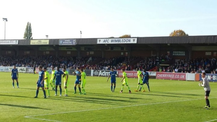 Action at Kingsmeadow, current home of AFC Wimbledon.