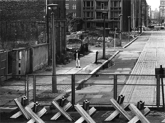 Man at Berlin Wall