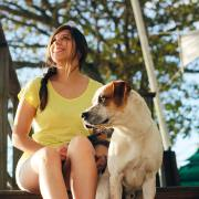 woman sitting with dog outside