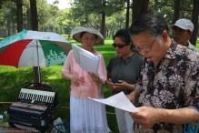 Elderly people singing in Jingshan Park, Beijing
