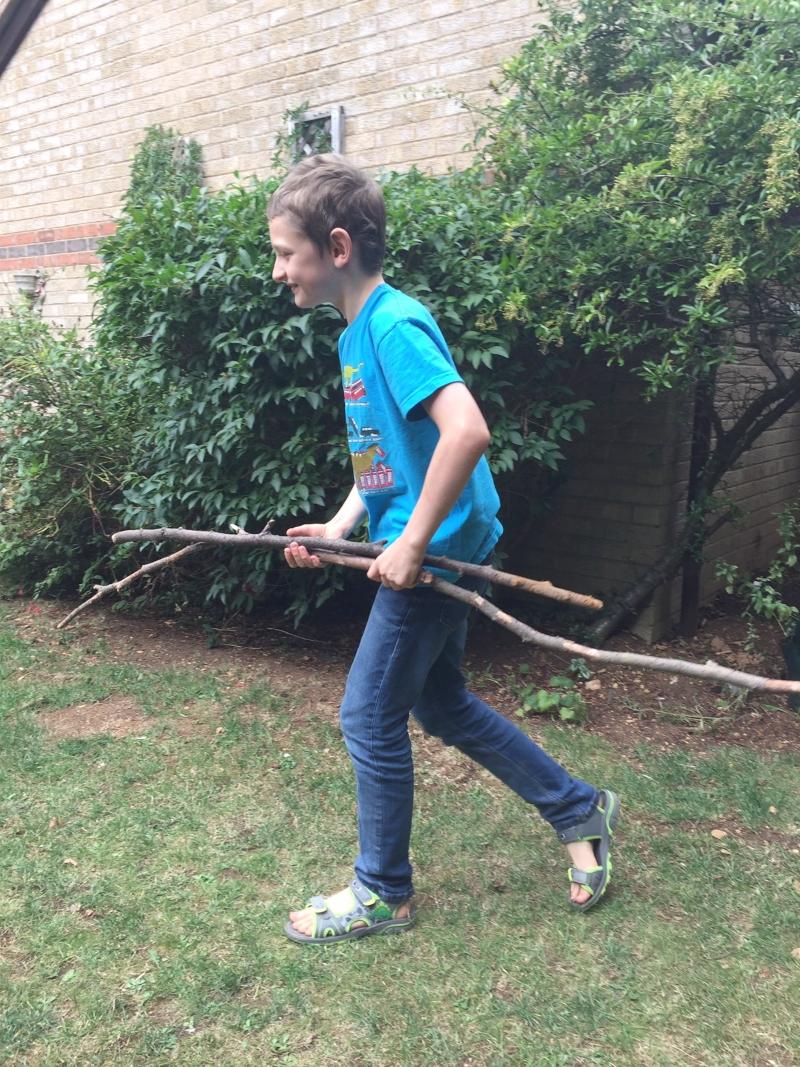 boy with sticks