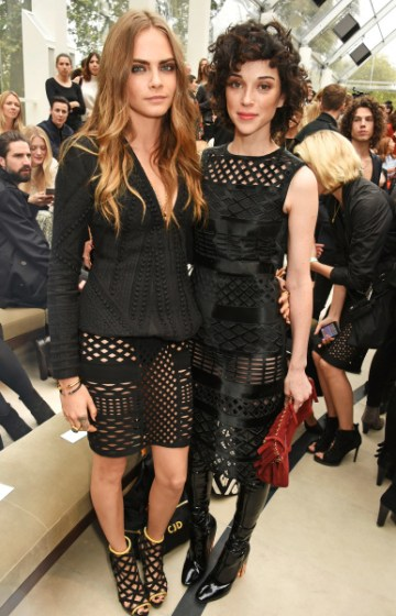 LONDON, ENGLAND - SEPTEMBER 21:  Cara Delevingne (L) and St Vincent attend the Burberry Womenswear Spring/Summer 2016 show during London Fashion Week at Kensington Gardens on September 21, 2015 in London, England.  (Photo by David M. Benett/Dave Benett/Getty Images for Burberry) *** Local Caption *** Cara Delevingne;St Vincent