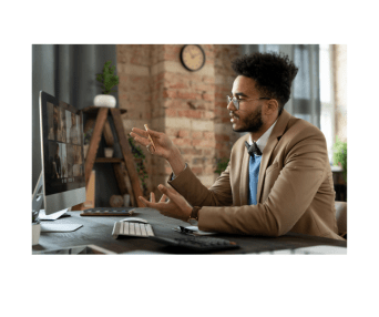 young black male leading an online workshop in a brown suit jacket