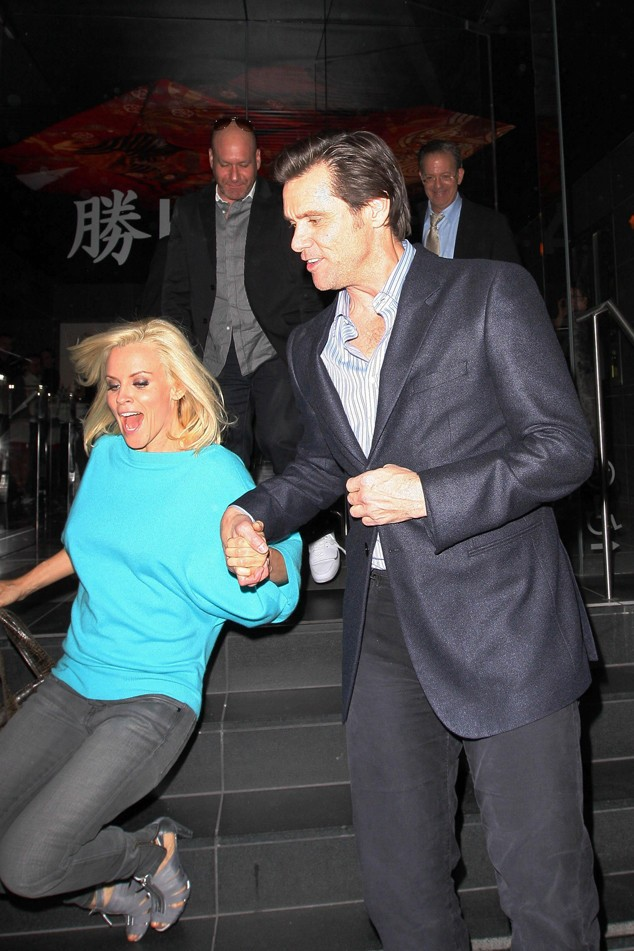 Watch out!! Jenny McCarthy takes a tumble out of Katsuya with boyfriend Jim Carrey on hand to help
