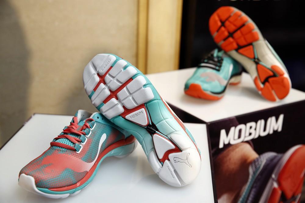 PUMA Mobium Elite Speed Women 全新「鞋面彈性貼合技術」,並採用獨家 「3D X型彈力繩」、「獨立緩衝塊墊」及「縮提式大底」等四大科技,讓跑者追求更快速的競跑快感。《產品售價$3780,圖由PUMA提供》-2