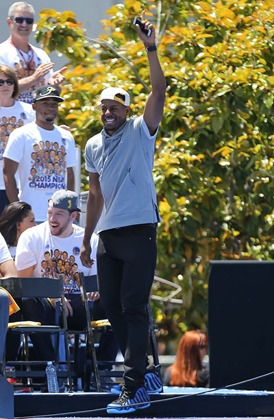 Jun 19, 2015; Oakland, CA, USA; Golden State Warriors guard Andre Iguodala (9) waves to fans during the Golden State Warriors 2015 championship celebration at the Henry J. Kaiser Convention Center. Mandatory Credit: Kelley L Cox-USA TODAY Sports