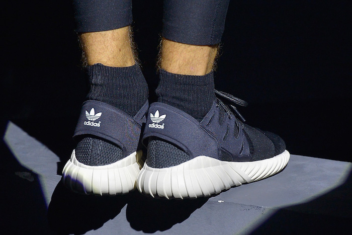 PARIS, FRANCE - JUNE 25:  Performer's shoes are seen during the Adidas Originals Tubular Paris Fashion Week Performance on June 25, 2015 in Paris, France.  (Photo by Dominique Charriau/Getty Images)