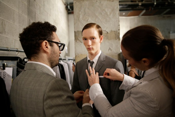 Matthew Pitt of Ontario, Canada, gets ready backstage before a presentation by Thom Browne during Men's Fashion Week in New York, Tuesday, July 14, 2015.  (AP Photo/Seth Wenig)
