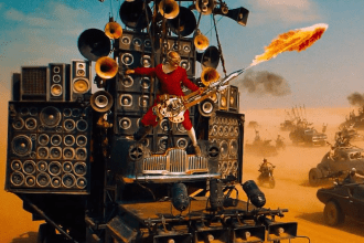 the-man-behind-the-awesome-flamethrower-guitar-player-in-mad-max-fury-road-is-a-popular-australian-musician