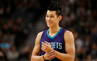 Nov 7, 2015; San Antonio, TX, USA; Charlotte Hornets point guard Jeremy Lin (7) smiles to the crowd during the first half against the San Antonio Spurs at AT&T Center. Mandatory Credit: Soobum Im-USA TODAY Sports