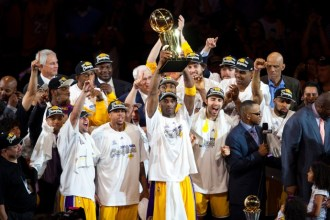17 June 2010:  Guard Kobe Bryant of the Los Angeles Lakers holds up the Larry O'Brien trophy and celebrates with his team after the Lakers defeat the Boston Celtics 83-79 and win the NBA championship in Game 7 of the NBA Finals at the STAPLES Center in Los Angeles, CA.