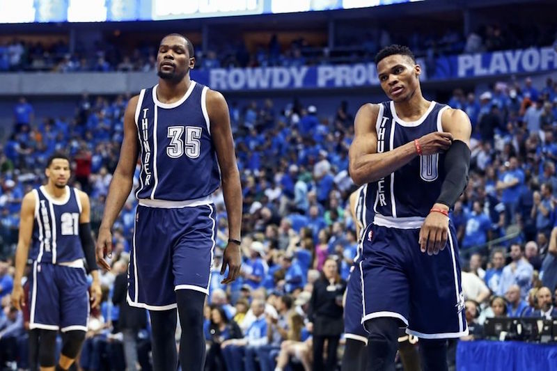 Apr 23, 2016; Dallas, TX, USA; Oklahoma City Thunder forward Kevin Durant (35) and guard Russell Westbrook (0) react at the end of the second quarter against the Dallas Mavericks in game four of the first round of the NBA Playoffs at American Airlines Center. Mandatory Credit: Kevin Jairaj-USA TODAY Sports