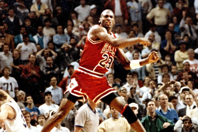 The Chicago Bulls' Michael Jordan reacts after hitting the game-winning basket over Cleveland's Craig Ehlo, left rear, in Game 5 of the NBA playoffs May 7, 1989, in Cleveland, Ohio.  (Ed Wagner Jr./Chicago Tribune/MCT)
