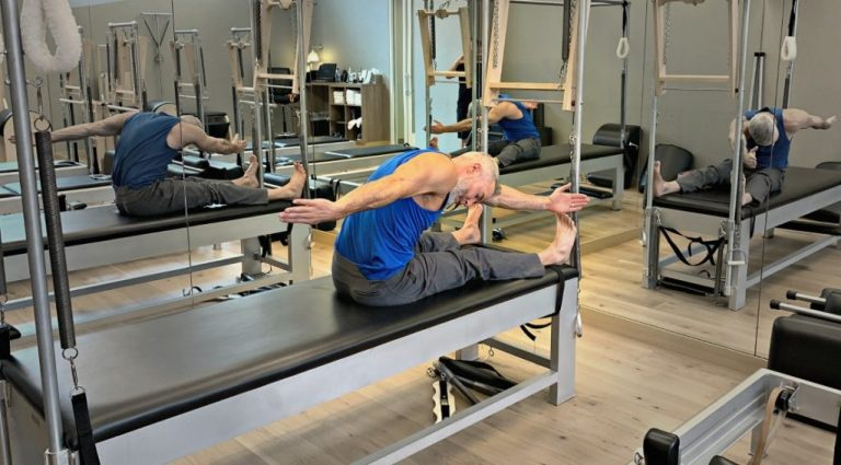 Dane Findley demonstrates the Saw Exercise in pilates mat work.